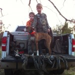 Daniel Bullock and Ty Ferguson with 'Bela' after a successful squirrel hunt.