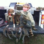 Daniel Bullock and Bela after a successful squirrel hunt!