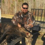 Another shot of Allen Manues with his moster 285lb boar.  Does he look tickled or what?