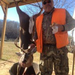 Rickey Gregory with this nice young buck taken on the property.