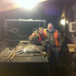 Eli Duffie and his great-grandfather, Ronnie Bullock, with Eli's second deer for the season.